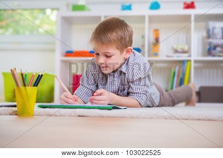 Adorable Boy Draws At Home