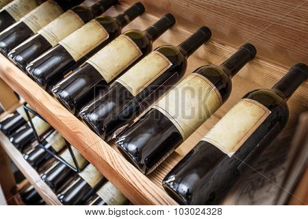 Old wine bottles on the wine shelf.