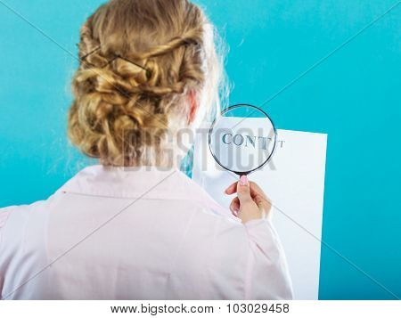 Businesswoman Uses Magnifying Glass To Check Contract