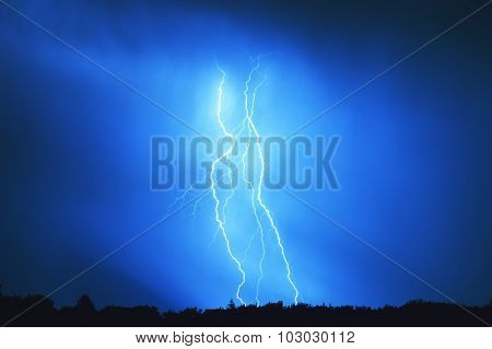 Multiple lightning bolt hits the ground at night