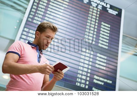 Young man at board at the airport