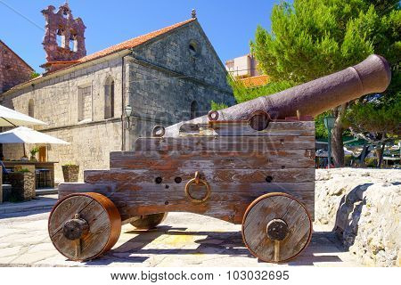 Old Gun And The All Saints Church, In Korcula