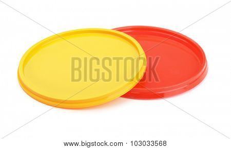 Two color plastic lids isolated on white