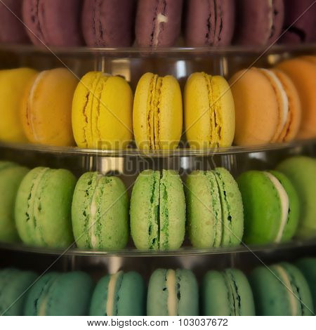 Macarons in different colors and flavours in a display