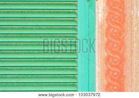 Detail Of Green Shutters And Red Wall