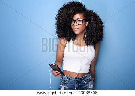 Young Girl Listening To Music.