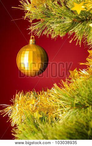 yellow ball on christmas tree
