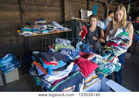 BELGRADE, SERBIA: SEPTEMBER 13, 2015: Volunteers bringing clothes for the immigrants and refugees from Middle East and North Africa heading to European countries.