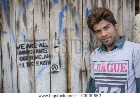 KOS, GREECE - SEP 28, 2015: Unidentified refugee. More than half are migrants from Syria, but there are refugees from other countries - Afghanistan, Pakistan, Iraq, Iran, Mali, Bangladesh, Eritrea.