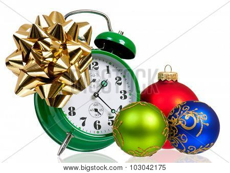 Alarm clock with christmas ball, isolated on white background