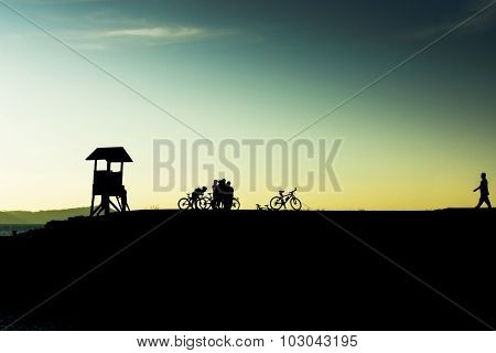 Outdoor Mountain Bike - Cyclists Silhouettes On The Background.