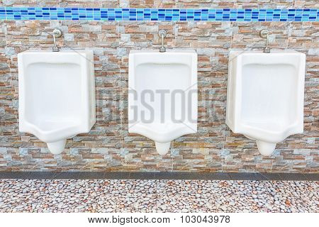 White Urinals In Men's Bathroom.