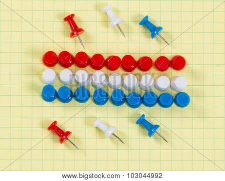 Thumbtacks And Graph Paper In Usa Flag Colors