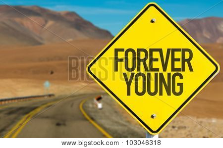 Forever Young sign on desert road