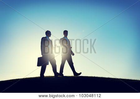 Businessmen Walking Discussion Commuter Concept