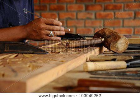 Wood carving tools at craftsman workshop
