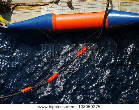 Flotation Collars At The Back Of Offshore Supply Vessel To Prevent Hose Falling Down If Parted.