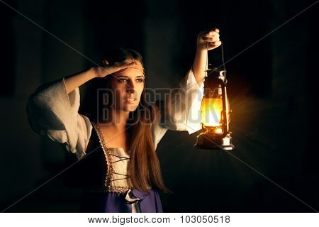 Beautiful Medieval Princess Holding Lantern Looking Outside
