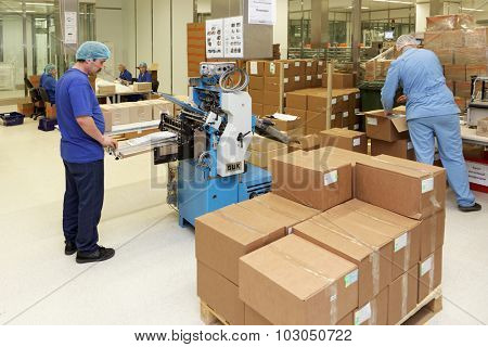 ST. PETERSBURG, RUSSIA - SEPTEMBER 24, 2015: Workers rolling instructions for medications on the Solopharm plant. The modern pharmaceutical plant was built using Good Manufacturing Practice standards