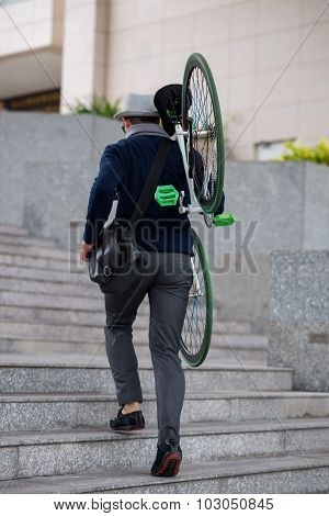 With bike on a shoulder