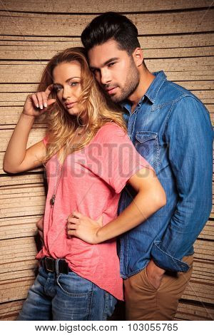 man leaning his head on his girlfrends shoulder while she is scratching her head