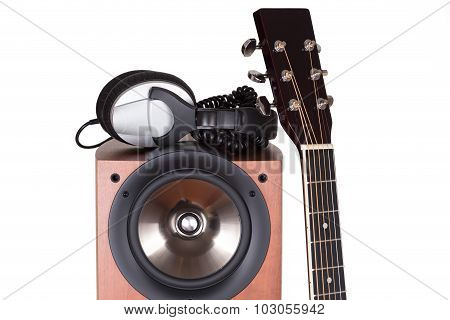 High Loudspeaker Tower With Acoustic Guitar