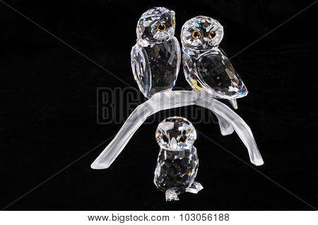 Three crystal owls.
