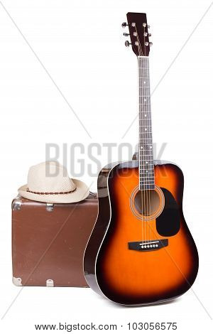 Guitar With An Old Suitcase And A Hat