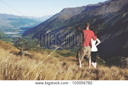 Couple Looking Afar Mountain And Lake Concept