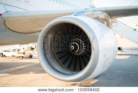 Modern Engine Of Passenger Airplane In Airport.