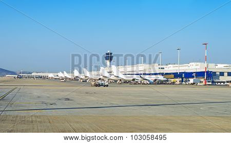 Many Passenger Planes In The Airport.