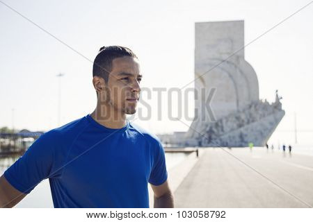 Sport man next to Padrão dos Descobrimentos at Lisbon, Portugal