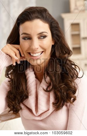 Closeup portrait of happy smiling young attractive woman, looking away.
