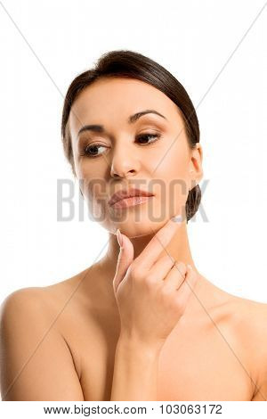 Pensive spa woman touching chin