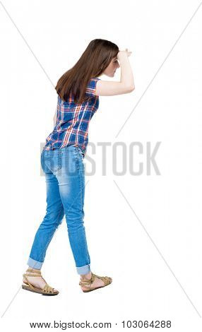 back view standing young beautiful  woman.  girl  watching. Rear view people collection.  backside view person.  Isolated over white background. Girl in blue plaid shirt with short sleeves looks right