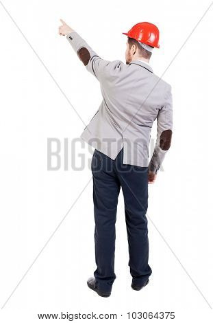Back view pointing young men in helmet. Young guy  gesture. Rear view people collection.  backside view person. Isolated over white background. bearded businessman at construction site refers to top