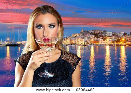 Blond tourist girl drinking vermouth cup at Ibiza nightlife sunset photomount