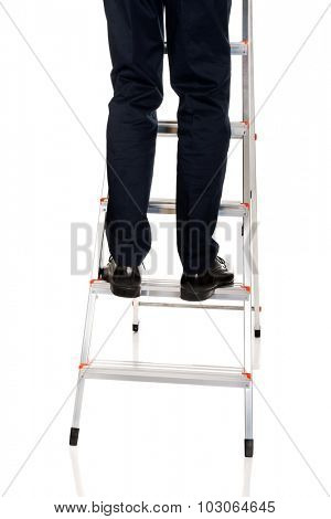 Close up male legs climbing ladder.
