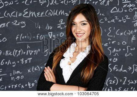 Teacher in her classroom ready to teach students