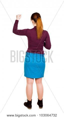 back view dancing young beautiful  woman. girl  watching. Rear view people collection.  backside view of person. Isolated over white background. girl in a blue skirt and a burgundy sweater made a fist