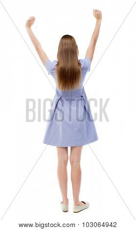 Back view of beautiful woman welcomes. Young teenager girl in jeans hand waving from. Rear view people collection. Isolated over white background. girl in blue dress and happily waving his hands.