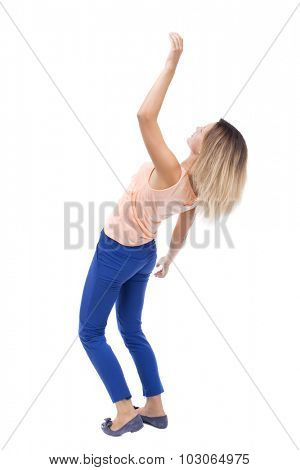 Balancing young woman.  or dodge falling woman. Rear view people collection.  backside view of person.  Isolated over white background. Blonde in blue pants and a pink blouse falls on his back.
