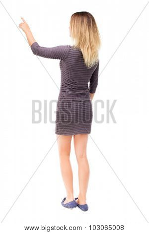 Back view of  pointing woman. beautiful girl. Rear view people collection.  backside view of person.  Isolated over white background. Girl in purple dress shows a finger to the left.