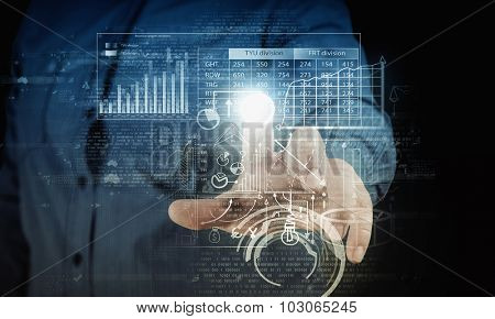 Businessman hand pushing business graph on touch screen interface