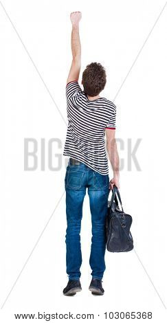 Back view man with bag.  Raised his fist up in victory sign. Rear view people collection.  backside view of person. Isolated over white background. guy in flying Superman pose with fashionable bag.