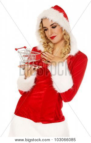 Santa woman holding a small trolley.