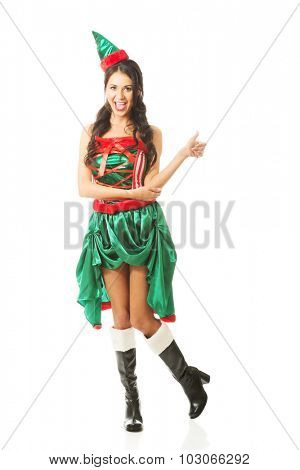 Full length woman wearing elf clothes showing thumbs up.
