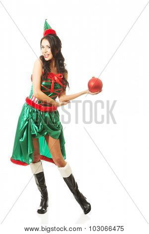 Full length woman holding christmas bubble on the left hand.