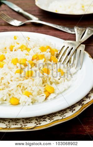 basmati rice in white plate witn sweet corn