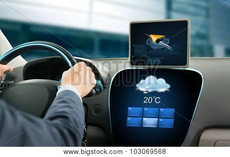 transport, business trip, technology and people concept - close up of businessman driving car with navigator on tablet pc and on board computer showing weather forecast